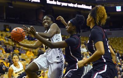 Amber Smith drives toward the basket (copy)