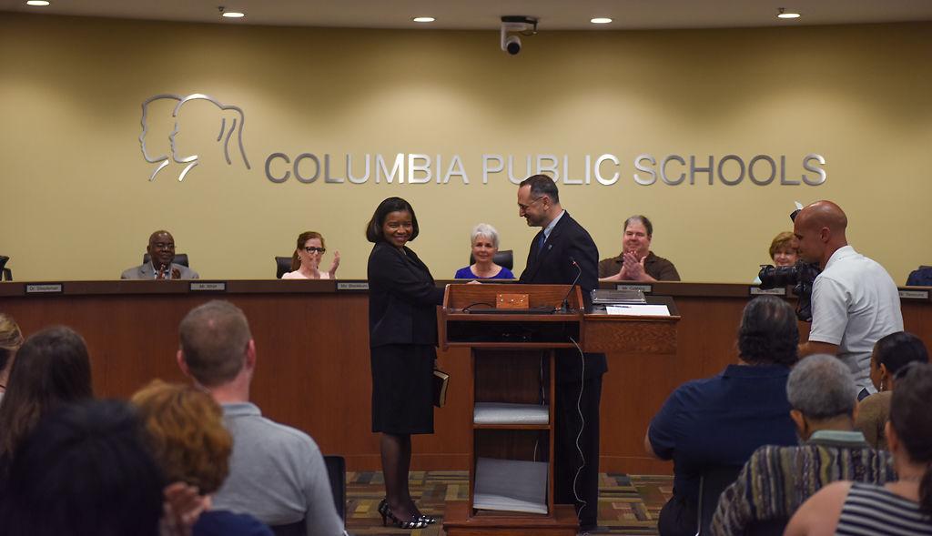 Della Streaty-Wilhoit, left, is sworn in by Peter Stiepleman