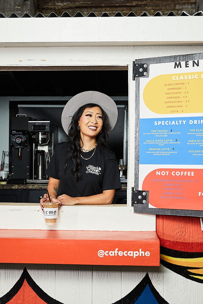 Jackie Nguyen, owner of Cafe Cà Phê, stands inside of her Vietnamese coffee truck
