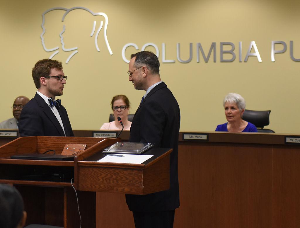 Blake Willoughby, left, is sworn in by Peter Stiepleman