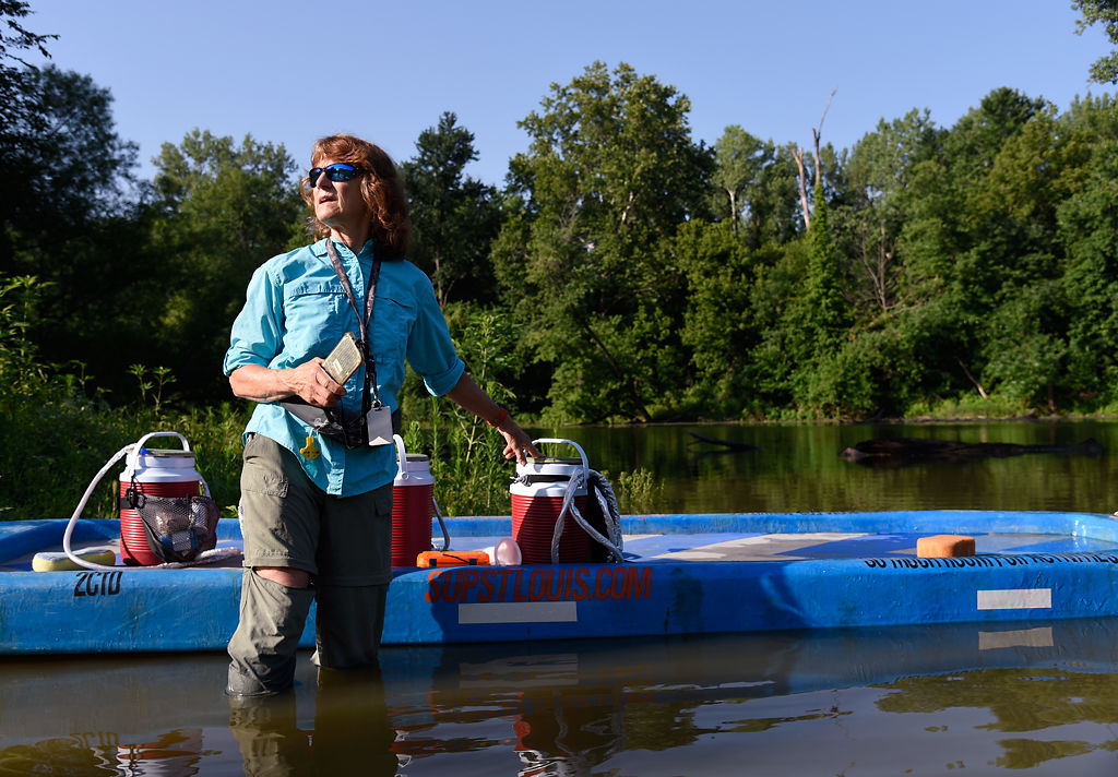 Linda LaFontaine puts supplies on the paddleboard