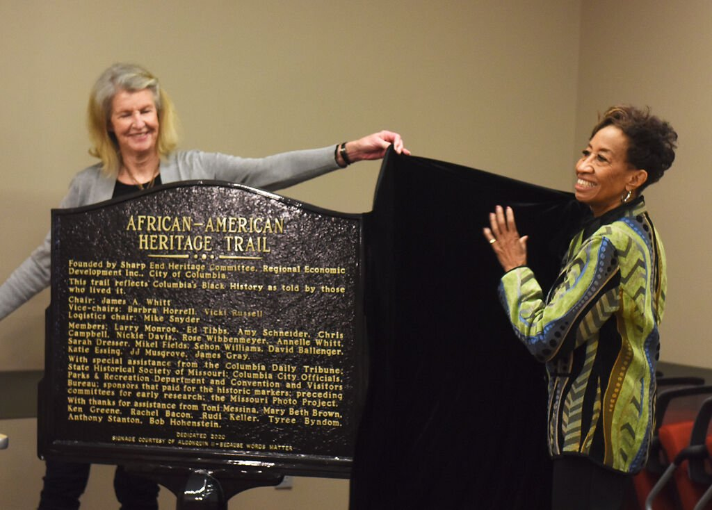 Vicki Russell and Barbra Horrell unveil the African American Heritage Trail marker