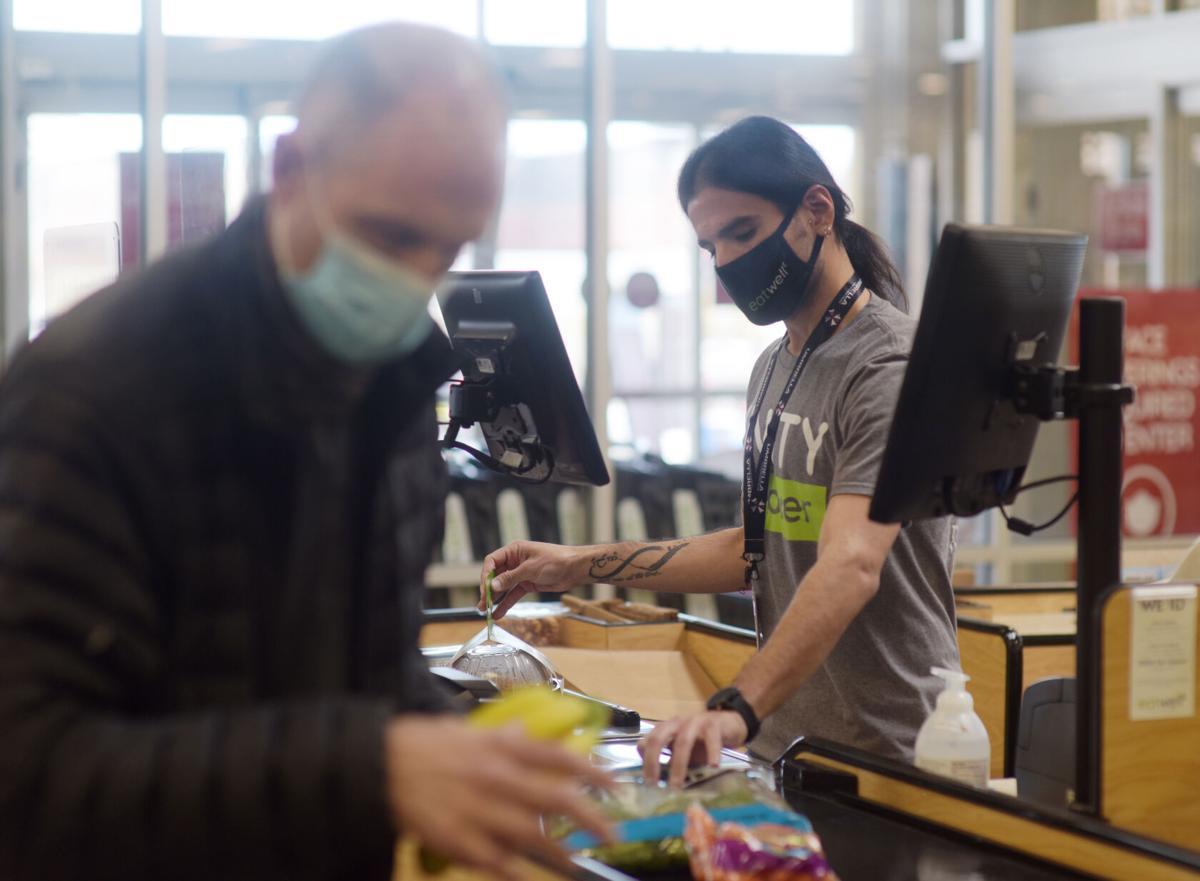 Roberto Cordero checks out a customer