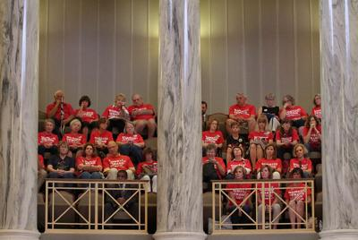 Volunteers of Moms Demand Action sit in the fourth floor gallery