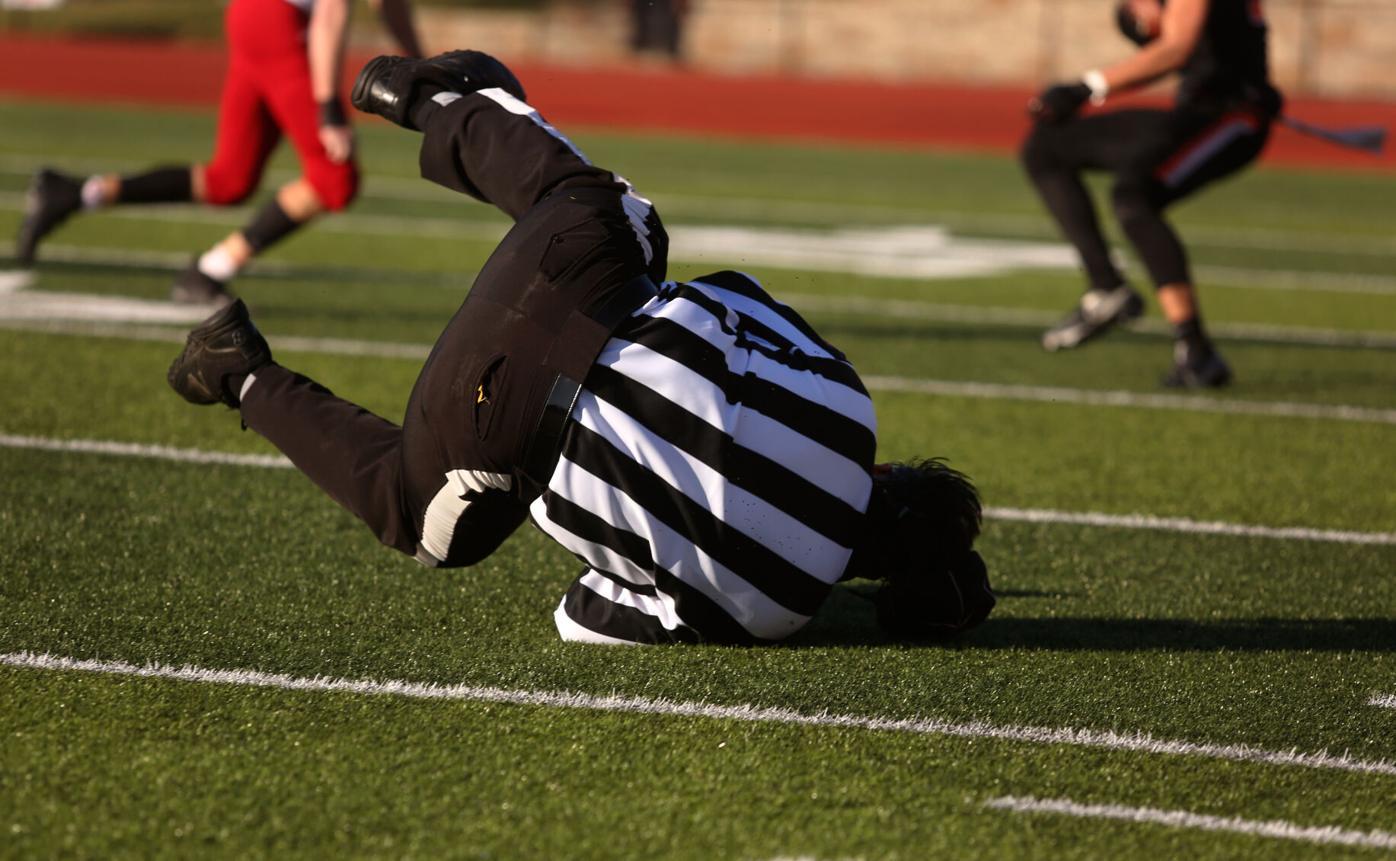Line judge Edward Hogan falls to the ground