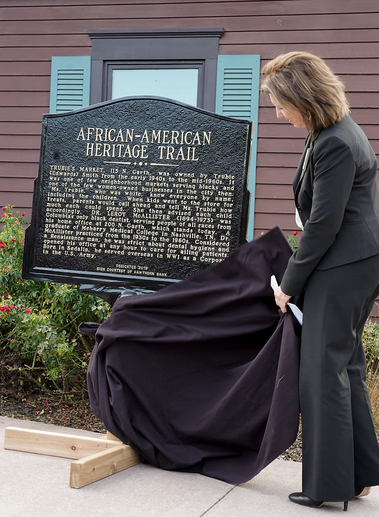 Kathleen Brugenhemke, the chief operations officer and rich manager at Hawthorn Bank, reveals the historical marker