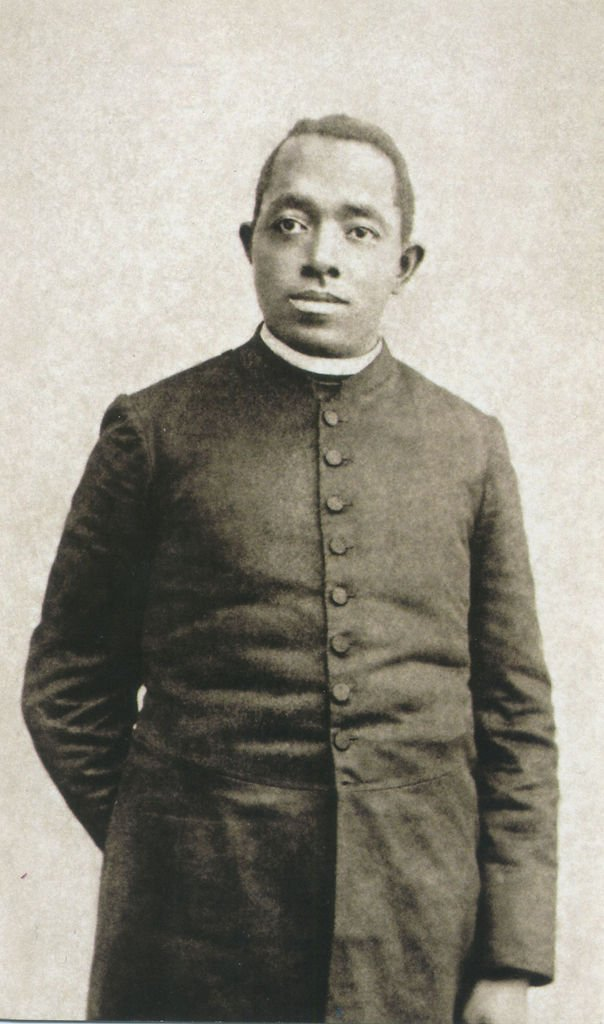 An image of Father Augustus Tolton is depicted on a prayer card