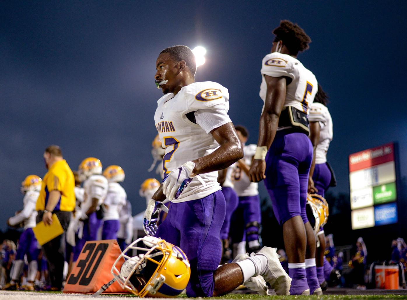 Hickman Wide Receiver LJ Williams get down to tie his cleats