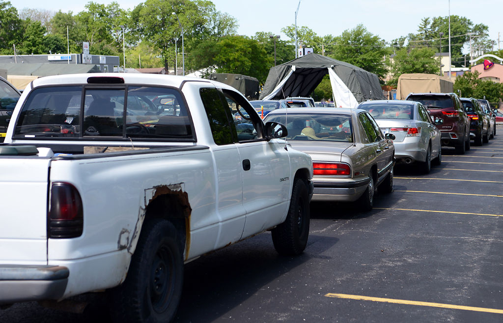 The National Guard set up a drive-through COVID-19 testing station at Hickman High School