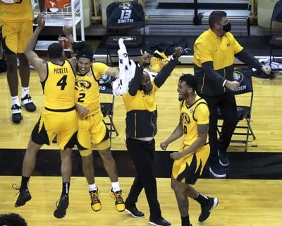 Missouri players and coaches celebrate after the buzzer sounds