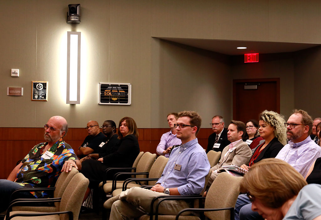 People listen to the two candidates for city manager answer questions
