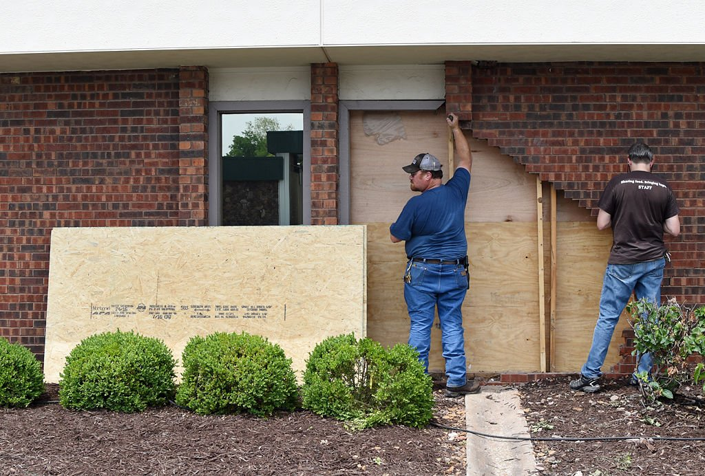 Truck crashes into food bank leaving hole local michael johnson and daryle bascom repair a hole in the wall of the food bank for solutioingenieria Gallery