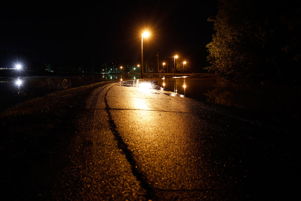 Water floods over both sides of West Jefferson Street