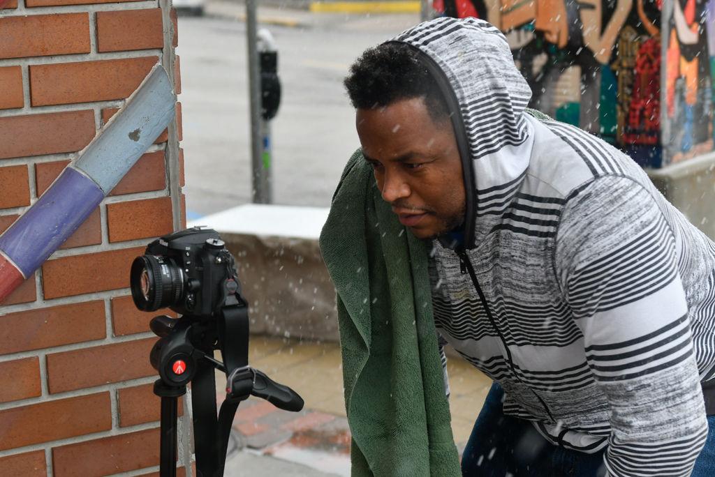 Sean Mearidy sets up his camera