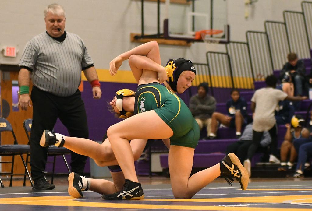 Rock Bridge's Anna Stephens wrestles Hickman's Sophia Pinkstaff