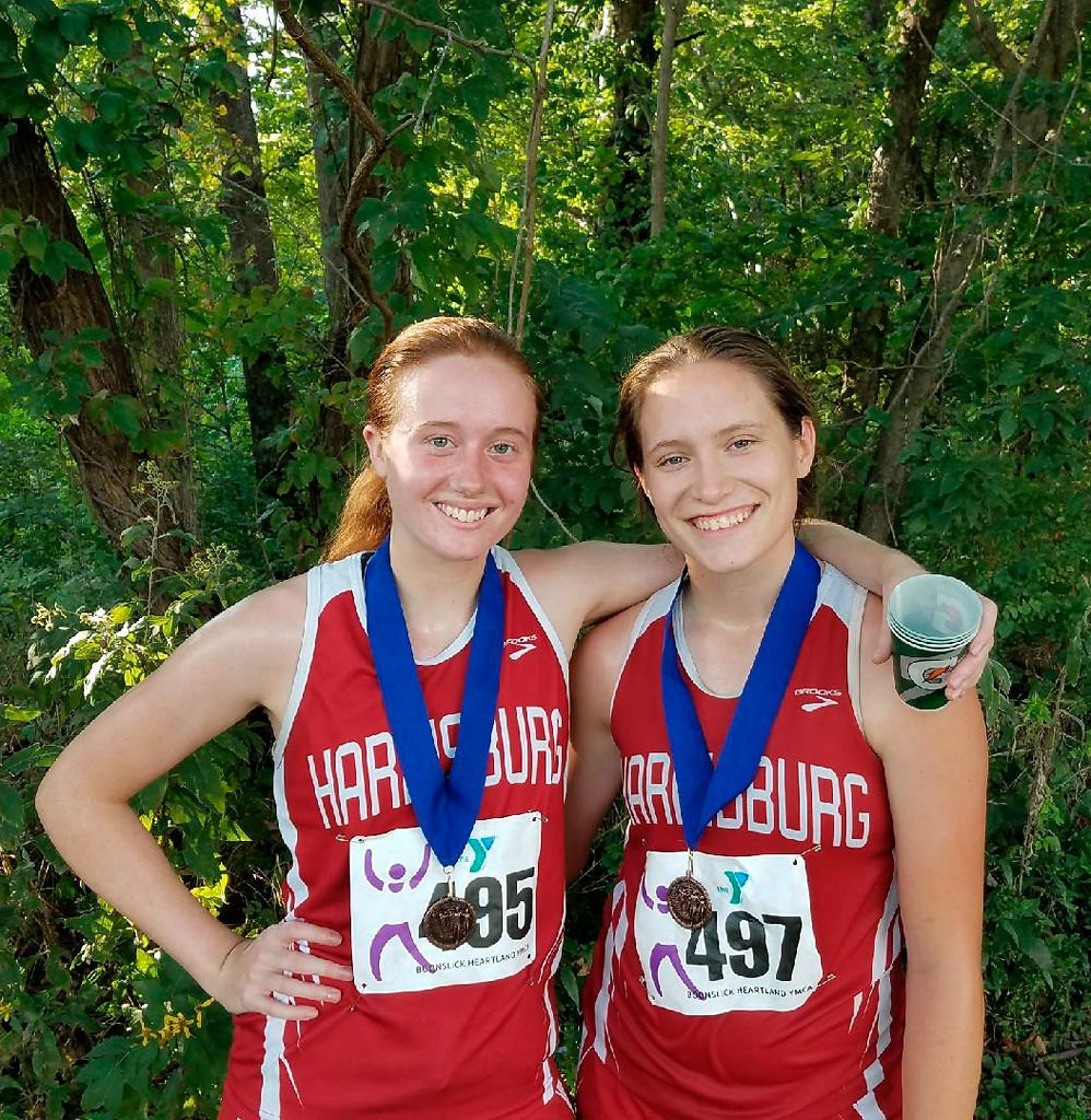 Zoe Carr, left, and Kaitlyn Weil pose with their medals