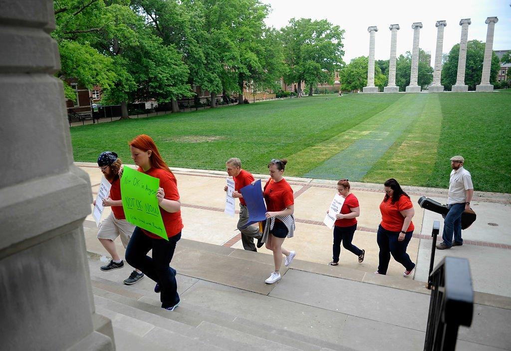Faculty and graduate students walk into Jesse Hall