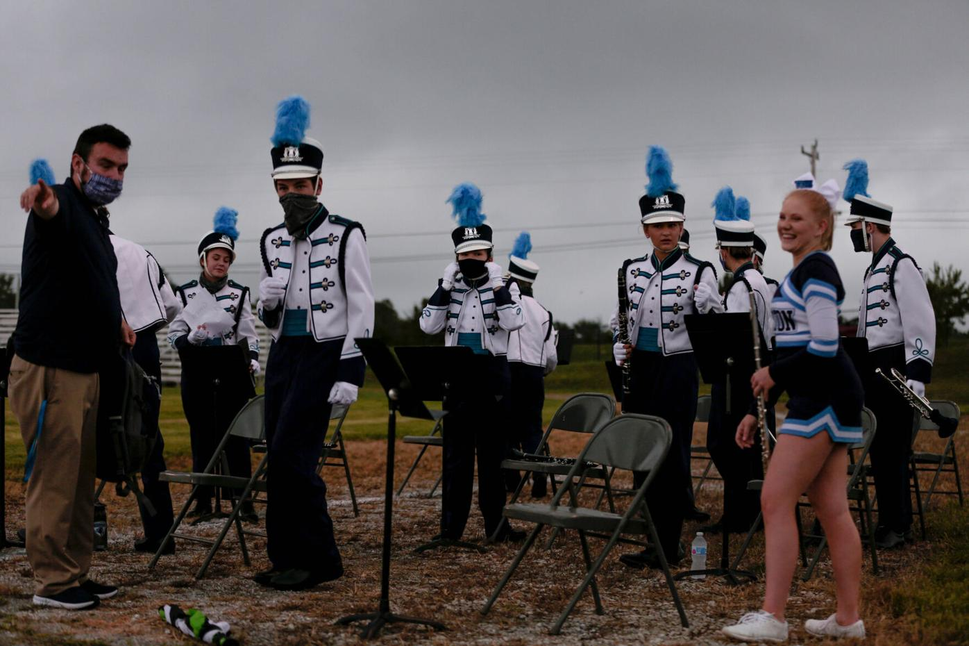 Tolton Catholic High School's marching band sets up for its pregame performance