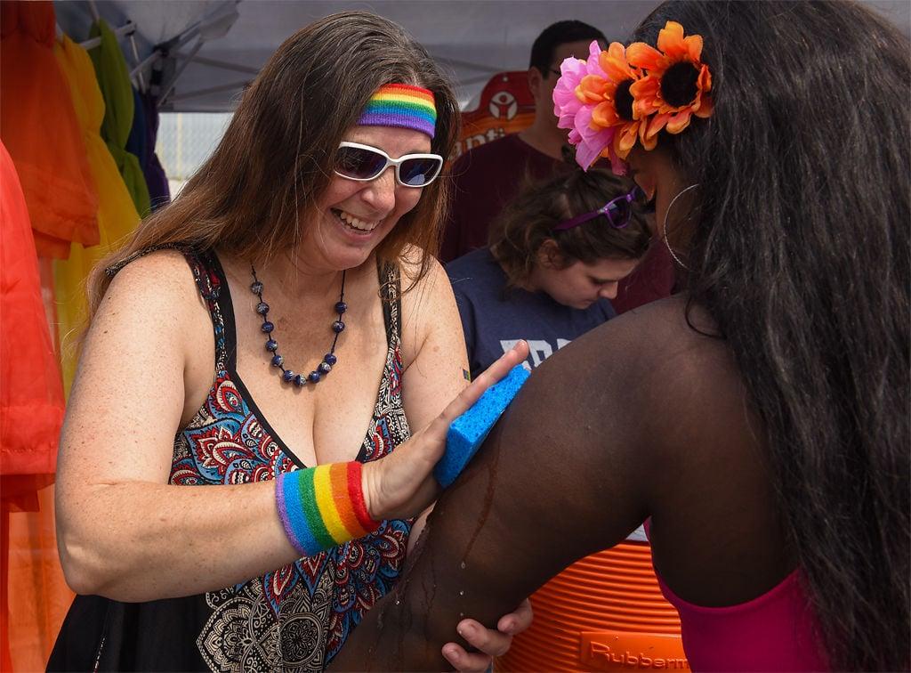 Rebekah Robertson puts temporary tattoos on attendees at the Mid-Missouri PrideFest