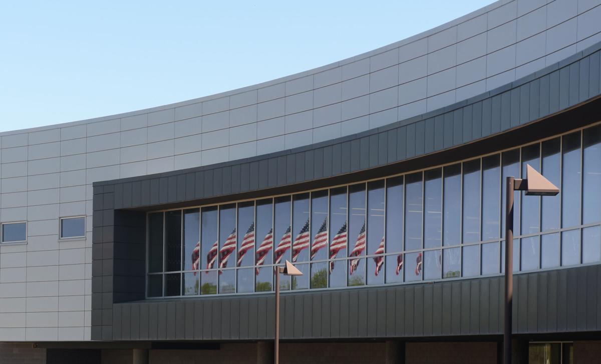 The American Flag reflects off Battle High School's windows