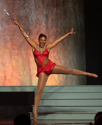 "Simone Esters performs a baton routine to the song ""One Night Only."""