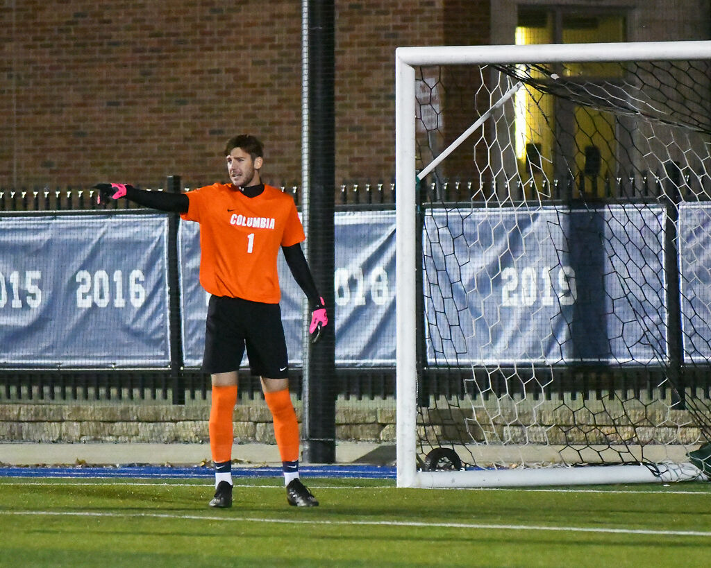 Columbia College goalkeeper Liam Gibbs points to the field after an attempted goal