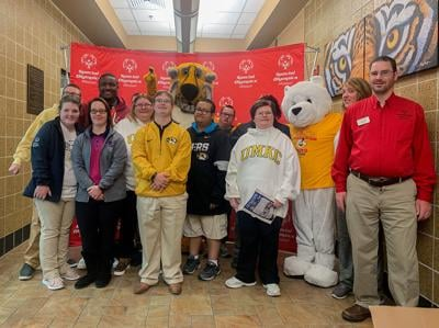 Special Olympics Missouri athletes pose with Truman the Tiger
