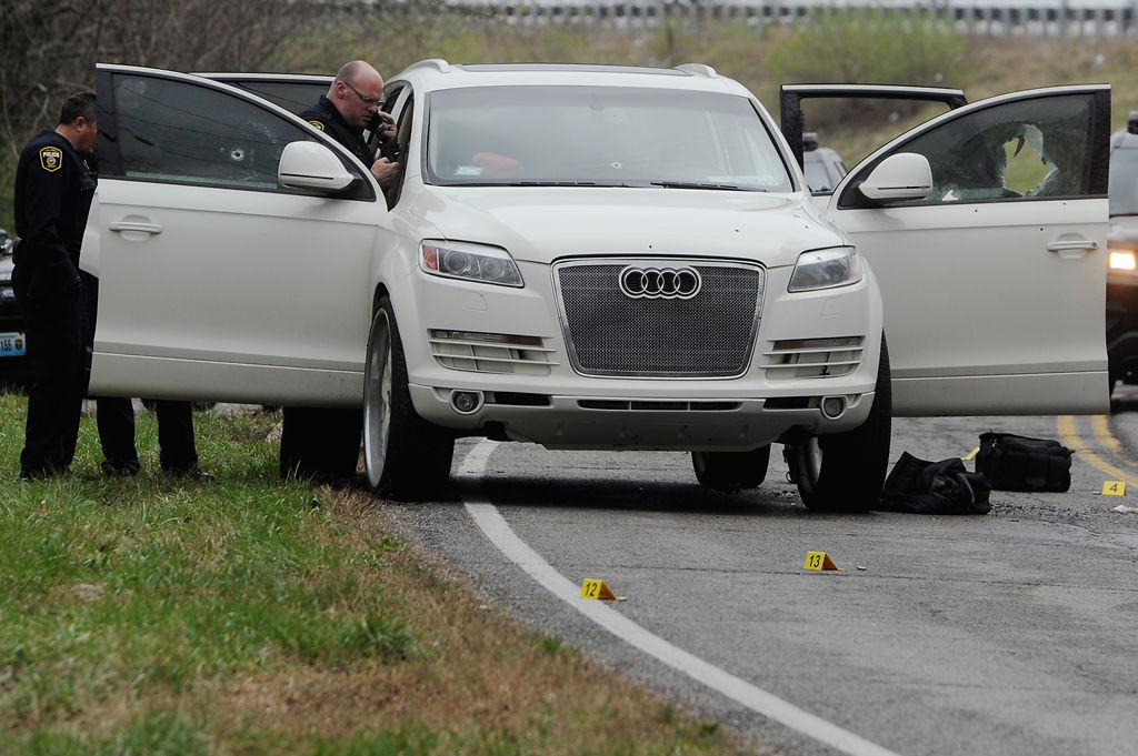 Columbia police officers examine a vehicle