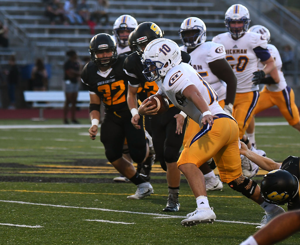 Hickman running back Felix Pippenger runs with the ball during their game