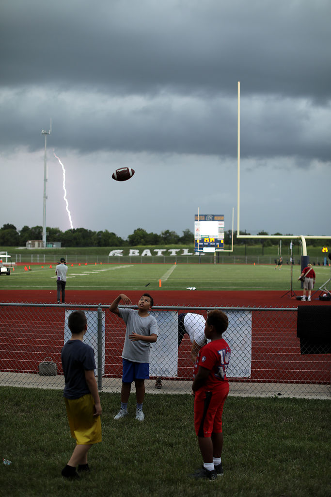 From left to right, Alex Fernandez, 12, Kaldin Lewis, 11, and Jarvis Lewis, 10, toss a football