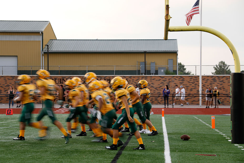 The Rock Bridge football team warms up