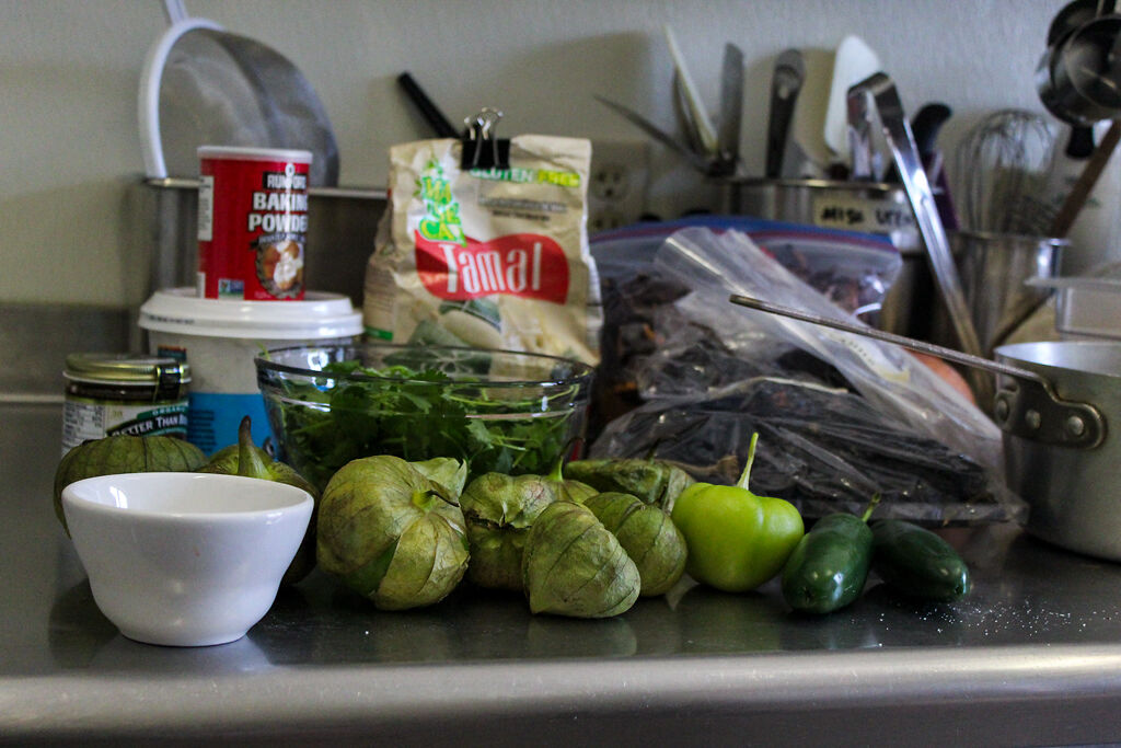 A stack of tomatillos sit on the counter
