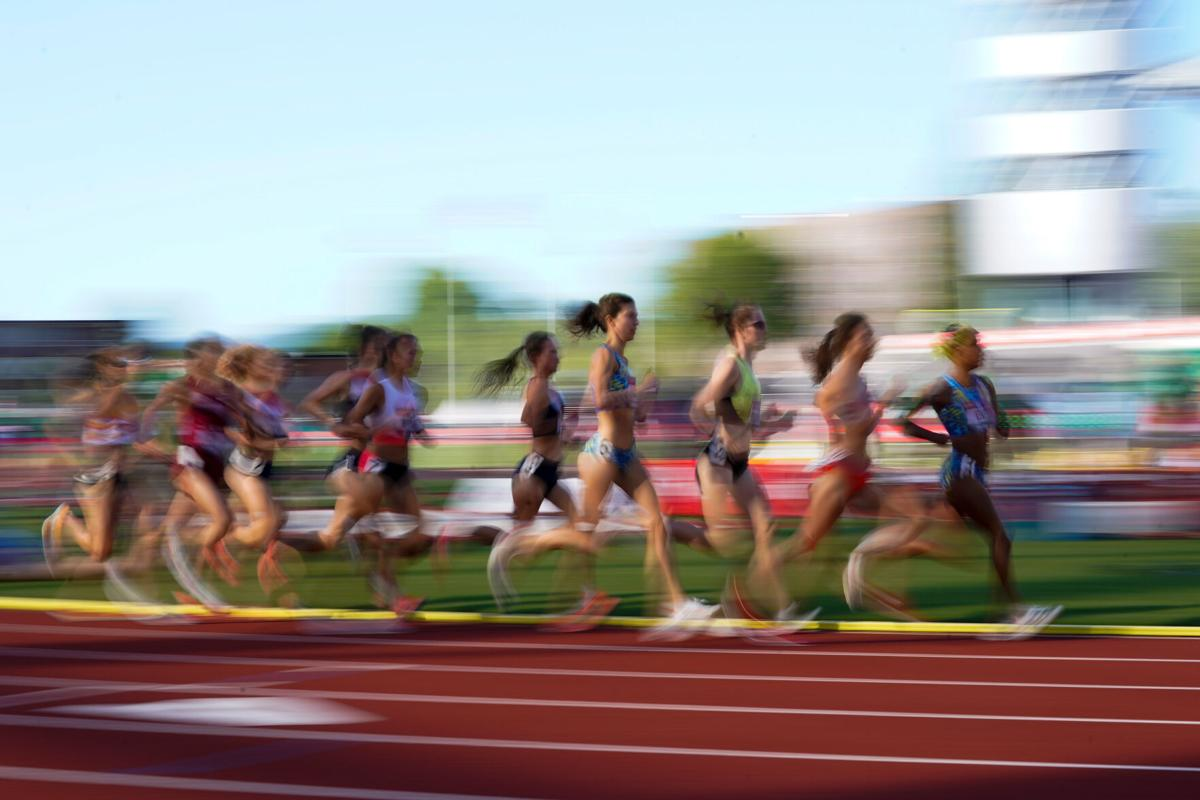 Runners compete during the prelims of women's 5000-meter run