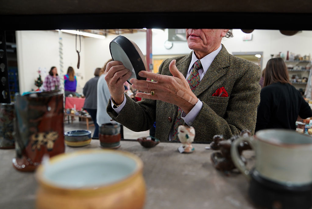 A customer examines a bowl made by Columbia College students Thursday at the semi annual pottery sale at Brown Hall.