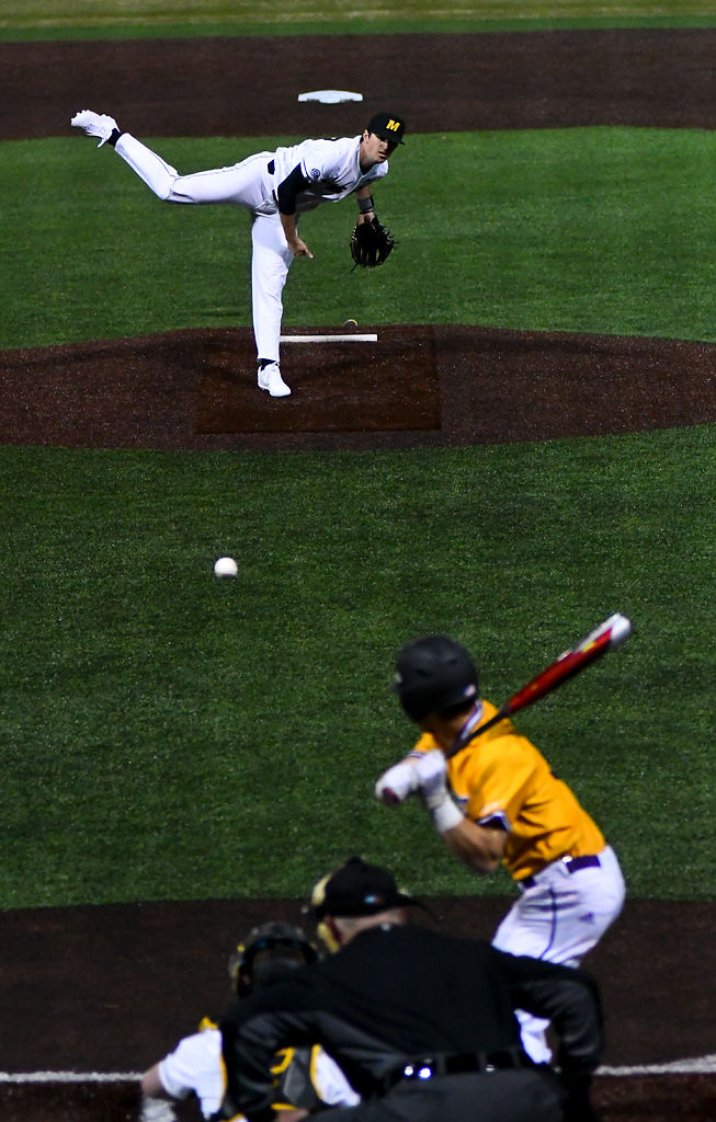 Missouri's Ian Bedell throws a pitch to Western Illinois's Kevin Raisbeck