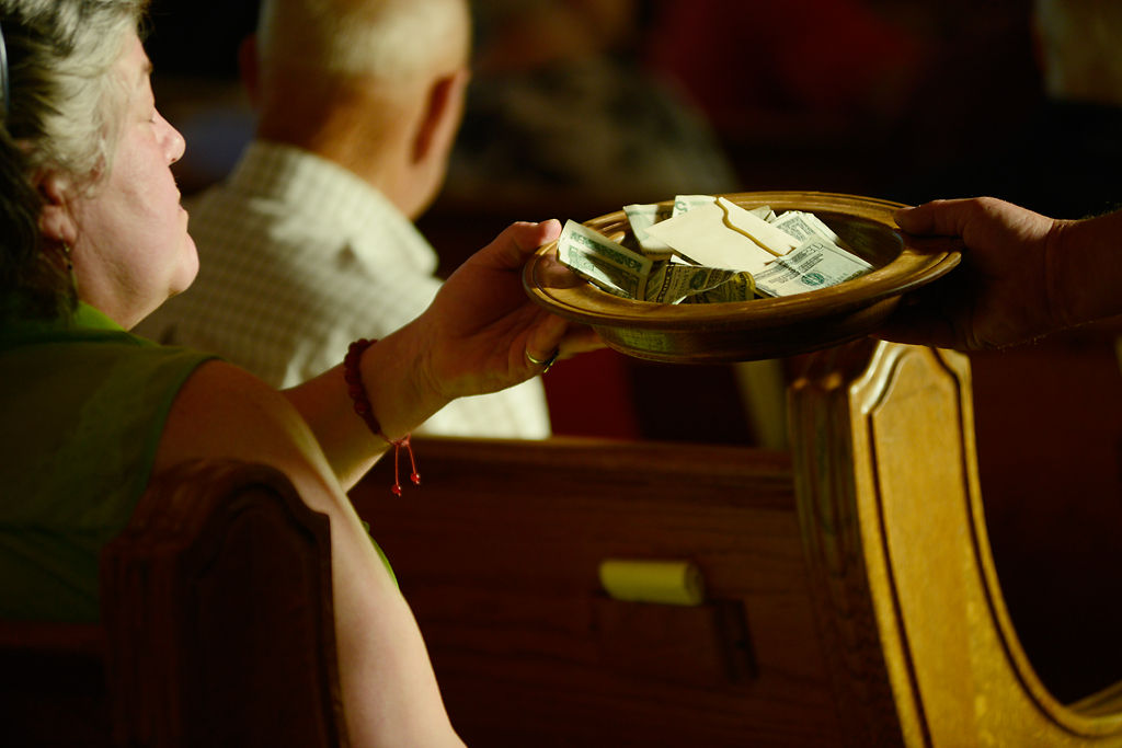 Offerings are collected at the end of a service