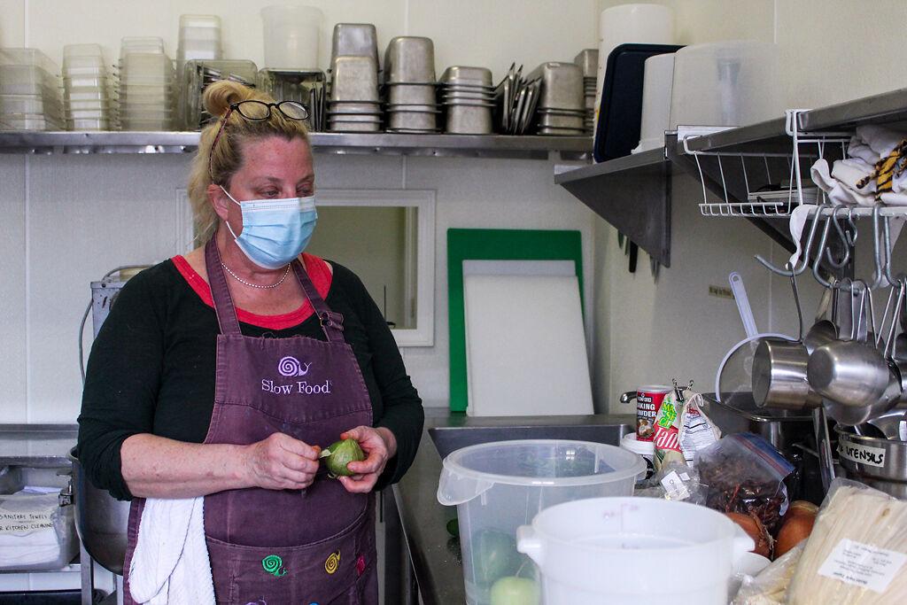Leigh Lockhart peels a tomatillo