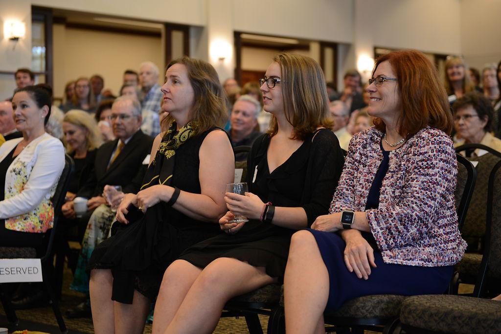 Melinda Cartwright, Alyssa Cartwright and Provost Garnett Stokes listen to MU Chancellor Alexander Cartwright