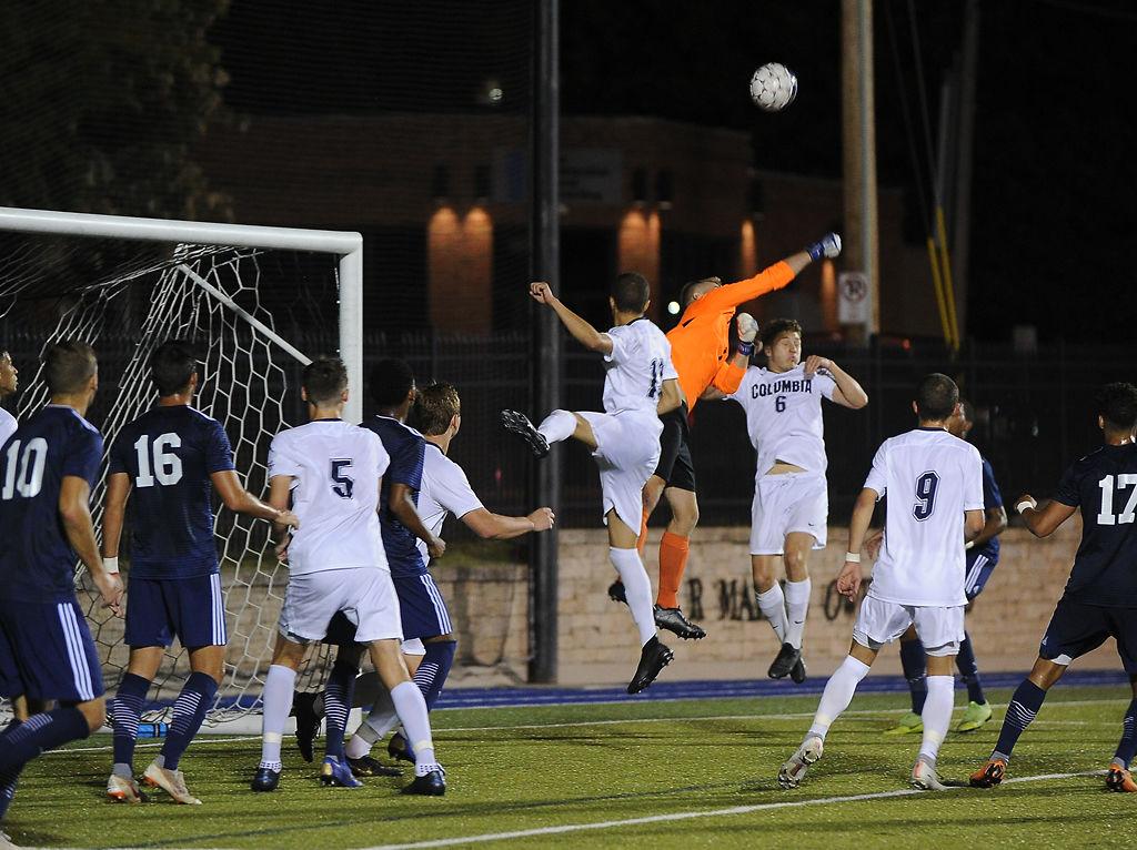 Columbia College senior Ryan Harrisskitt punches the ball away after an Oklahoma Wesleyan corner on Friday