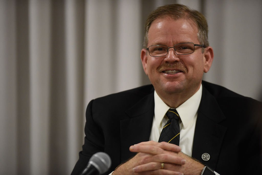 MU Chancellor Alexander Cartwright smiles as he addresses the media during a press conference at Jesse Hall