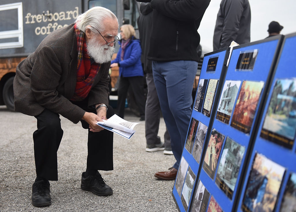 Denny Donnell looks at a poster board about the water history