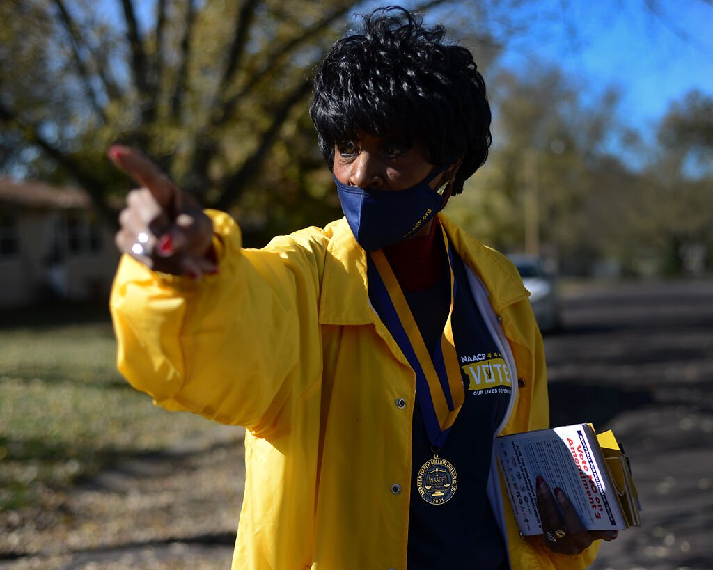 Mary Ratliff, president of the Columbia chapter of the NAACP, gives directions to volunteers