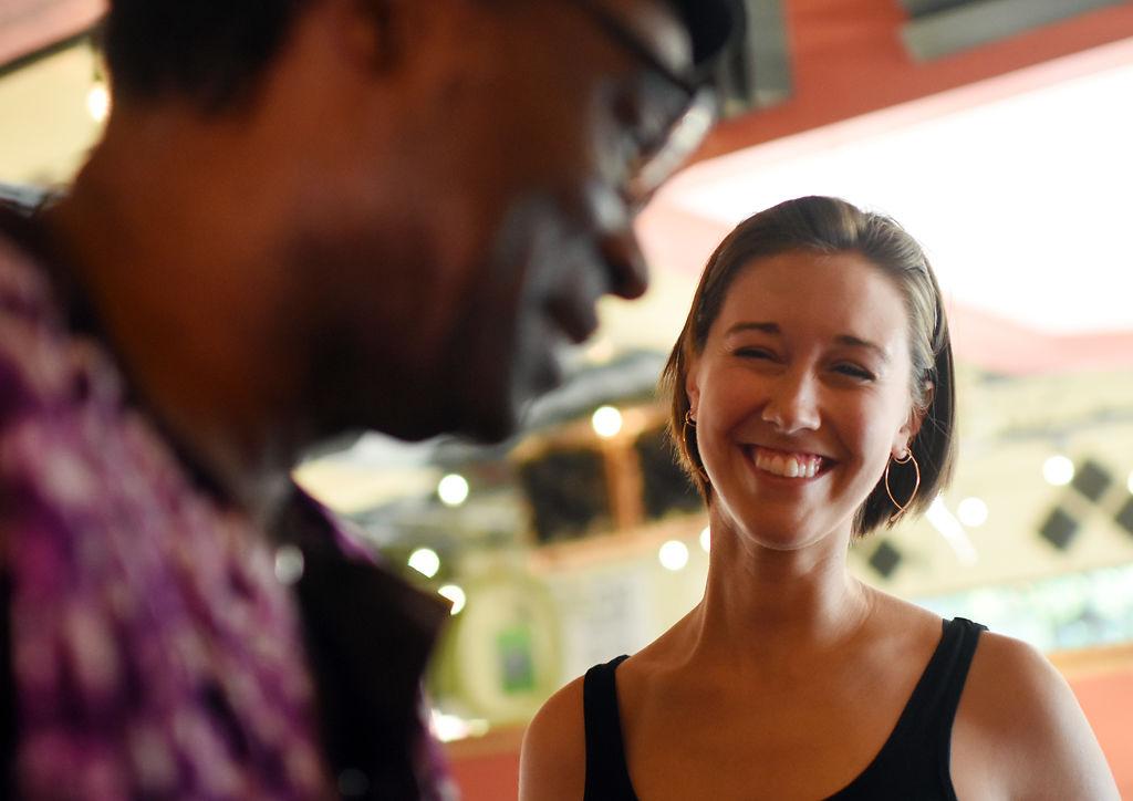 Abigail Rehard smiles at Anand Prahlad