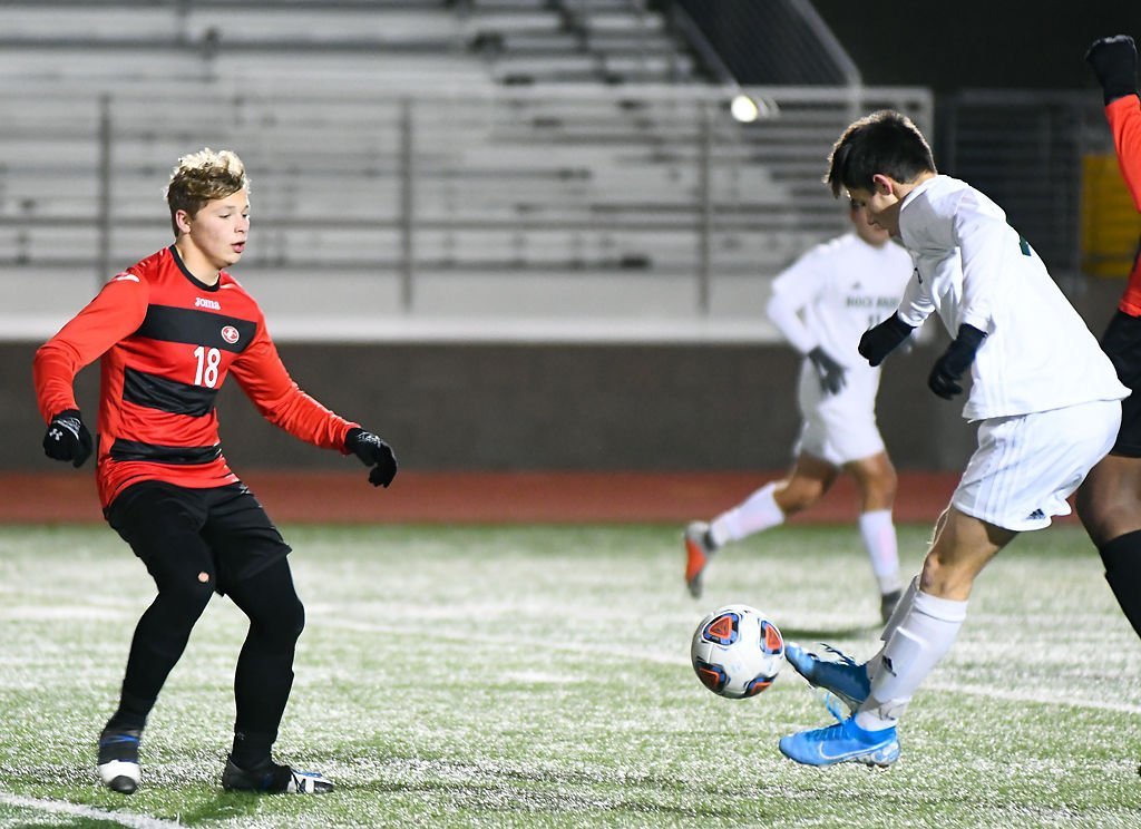 From left, Jefferson City defender and midfielder Will Kuster attempt to defend against Rock Bridge forward Lucas Godon in a game against the Jefferson City Jays Thursday
