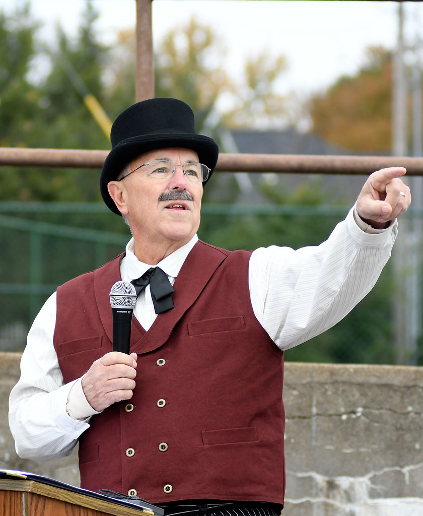 Richard Mendenhall gives a speech while acting in the character of Smithton Trustee Robert S. Barr