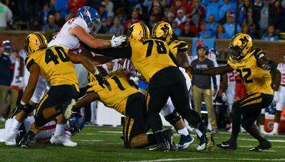 Missouri defensive tackle Kobie Whiteside fights at the line of scrimmage