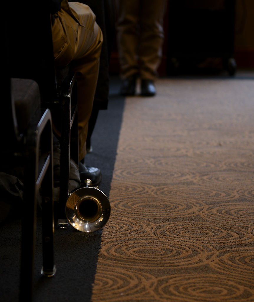 A trumpet lies on the ground after being played for a performance during the Veterans Day Wreath Laying Ceremony