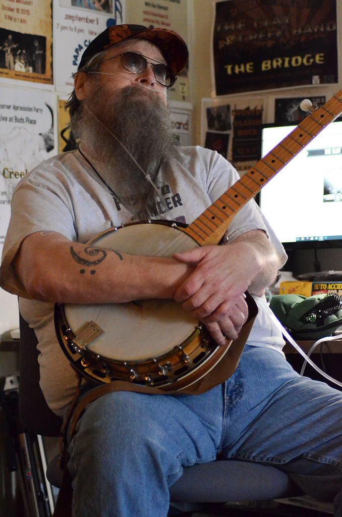 Clay Richmond talks about his condition of having both lung and throat cancer after playing his banjo