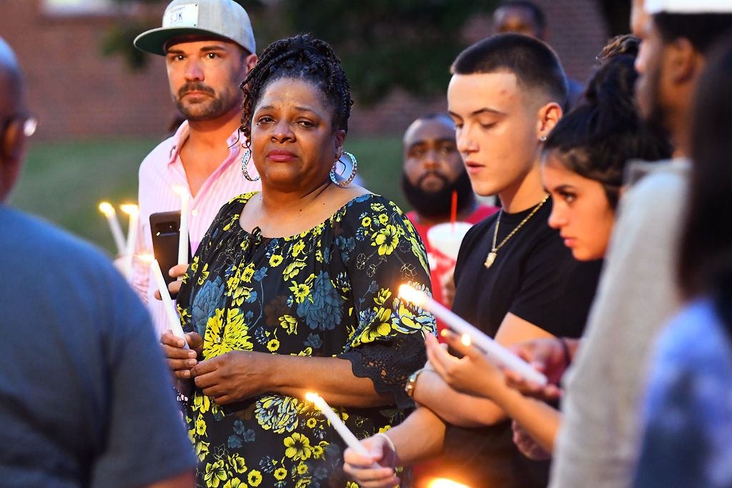 Cheryl Wright listens to a speaker at a vigil for her granddaughter, Nadria Wright