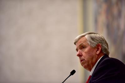 Mike Parson waits for members of the Senate